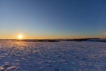 Die Sonne geht im Reckerstal unter und die Temperatur, welche sich auch tagsüber in den Minusgraden hält, sinkt immer weiter bis Nachts auf -18 Grad Celsius. [EOS5D Mark4 | ISO100 | f3,2 | 1/1000s | 19mm]