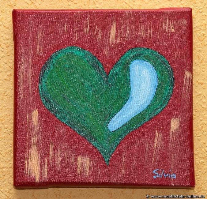 Wie man mit Acrylfarben Künstlern kann, wird an diesem Herz gezeigt.